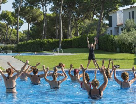 People dancing in the camping pool