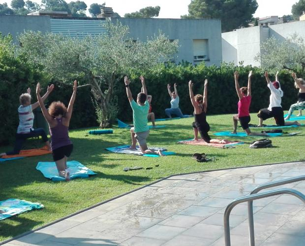 Yoga for adults by the campsite pool