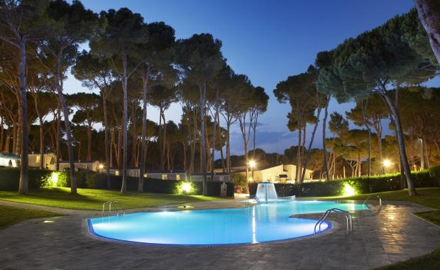 Illuminated pool at Camping Bungalows Interpals