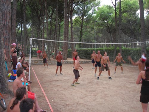 Group of boys playing beach volleyball
